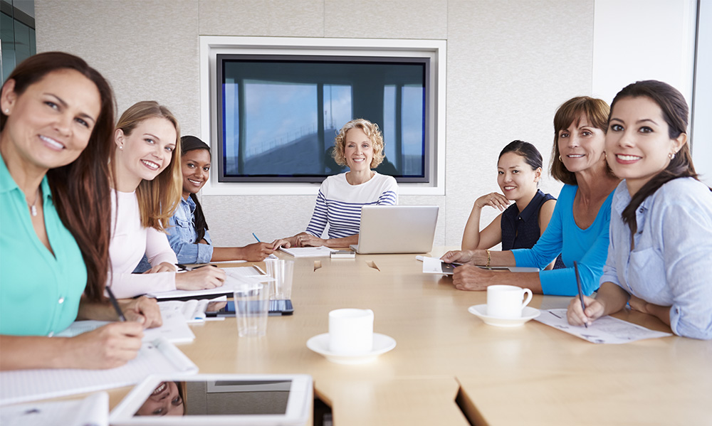 women at board room table