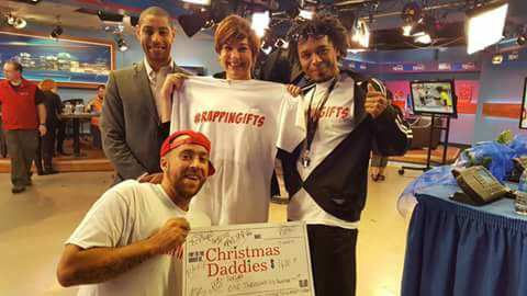 Organizers of Rappin' Gifts presenting the funds to the Christmas Daddies Telethon.